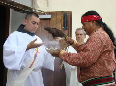 A member of the Tigua First Nation offers a blessing of purification to Friar Andy before his ordination.