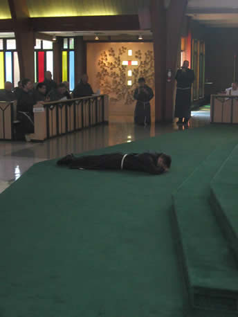 Friar Reto prostrates during the Litany of Saints prior to making his vows.